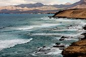 Surf on the rocky coast, Fuerteventura, Canary Islands, Spain