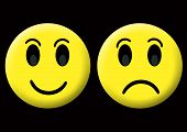 foto of smiley face  - happy and sad smiley at the black background - JPG