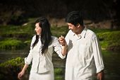 picture of walking away  - Young couple are walking and holding hands.