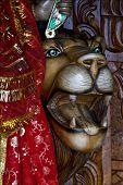 pic of brahma  - head of lion precious stone marble wood statue of a Hinduism women Shiva vishnu Brahma in a temple near a lake in mauritius africa - JPG