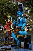 image of brahma  - marble blue wood statue of a Hinduism snake Shiva vishnu Brahma in a temple near a lake in mauritius africa - JPG