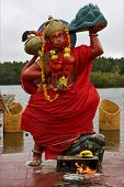 picture of brahma  - marble wood statue of a Hinduism monkey Shiva vishnu Brahma in a temple near a lake in mauritius africa - JPG