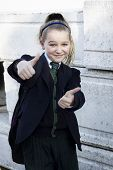 picture of tweeny  - School girl with uniform doing thumbs up positive feeling - JPG