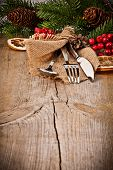 stock photo of christmas meal  - Vintage silverware on rustic wooden background with christmas decoration - JPG
