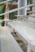 stock photo of bleachers  - A set of metal bleachers in an empty baseball field - JPG