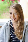 stock photo of laugh out loud  - A confident modern and relaxed teen laughing out loud - JPG