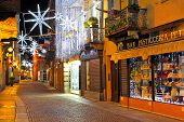 ALBA - DECEMBER 03: Popular tourist street in old historic center with shops, bars and restaurants i