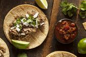 stock photo of tacos  - Traditional Pork Tacos with Onion Cilantro and Lime - JPG