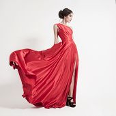 foto of superstars  - Young beauty woman in fluttering red dress - JPG