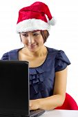foto of long distance relationship  - young Asian female working or on a webcam chat during Christmas - JPG