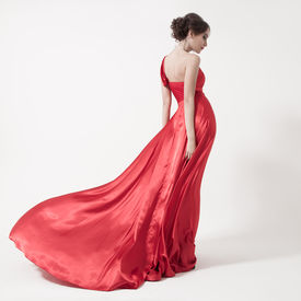 picture of flutter  - Young beauty woman in fluttering red dress - JPG
