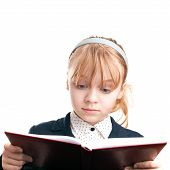 Closeup Portrait Of Blond Caucasian Schoolgirl Reading Book Isolated On White