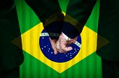 image of same sex  - Two gay men stand hand in hand before a marriage altar featuring an overlay of the flag colors of Brazil having just been legally married under the Same - JPG