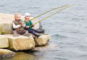 Funny kids catching fish.