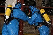 pic of decontamination  - man in chemical suit for cleaning operation - JPG