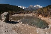 picture of jade blue  - White Water River Waterfall Under The Mountain Range With Nobody In Lijiang Near Jade Dragon Snow Mountain in Yunnan province - JPG