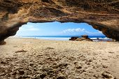 picture of cave  - Inside one of the caves at Caves Beach Australia at low tide on a beautiful sunny day Difficult exposure due to the extreme dynamic range inside the dark cave to sunny outside - JPG
