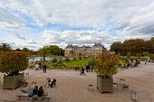 People enjoy autumn sunny day in the Luxembourg Garden