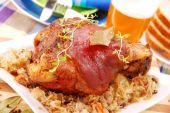 image of roasted pork  - pork knuckle baked with beer and sauerkraut - JPG
