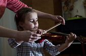 image of first class  - Adorable 3 year old little girl learning playing violin at music school class - JPG