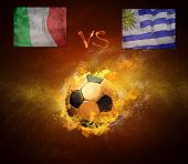 Hot soccer ball in fires flame, game Italia and Uruguay