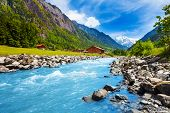 stock photo of breathtaking  - Breathtaking Swiss landscape with river stream - JPG