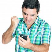 stock photo of hysterics  - Angry man punching his mobile phone  - JPG