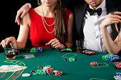 image of gambler  - A rich elegant couple gambling in a casino - JPG