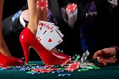 stock photo of flush  - A royal flush of hearts in a red pump - JPG