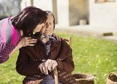 stock photo of take responsibility  - Senior woman with daughter taking care of her - JPG