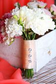Beautiful wedding composition with bouquet  on table on fabric background