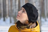 picture of beret  - Portrait of a woman in a black beret and a yellow jacket on a background of forest - JPG