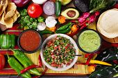 foto of avocado  - Stock image of traditional mexican food salsas and ingredients - JPG