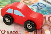 A red car on Euro bank notes