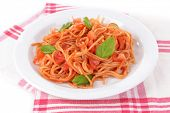 Pasta with tomato sauce on plate on table close-up