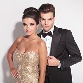 foto of caress  - Picture of an elegant couple posing together on studio background - JPG