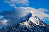 image of himachal pradesh  - Snowcapped summit top of mountain in Himalayas in clouds - JPG