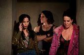 pic of pimp  - Frightened female prostitutes in hallway with pimp - JPG