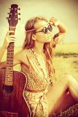 stock photo of gypsy  - Romantic girl travelling with her guitar - JPG