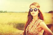 image of hippies  - Romantic hippie girl standing in a field - JPG
