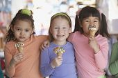 picture of chums  - Group of young girls eating ice cream cones - JPG