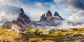 pic of south tyrol  - Great foggy view of the National Park Tre Cime di Lavaredo with rifugio Locatelli - JPG