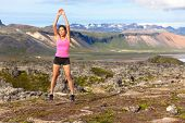 pic of squat  - Fitness woman jumping exercising outdoors doing jump squats in amazing nature landscape - JPG