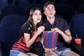 picture of cinema auditorium  - Young couple watching movie in cinema - JPG