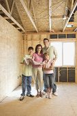 image of pre-adolescents  - Family with blueprints on construction site - JPG