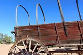 image of covered wagon  - Old wild west covered wagon on bright sunny day - JPG