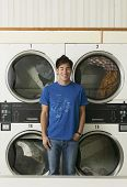 picture of laundromat  - Asian man in Laundromat - JPG