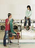 pic of mischief  - Asian couple in laundromat - JPG