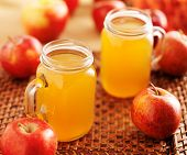 stock photo of masonic  - mason jars filled with hot apple cider - JPG
