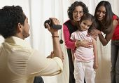 picture of mother law  - Indian father video recording family - JPG